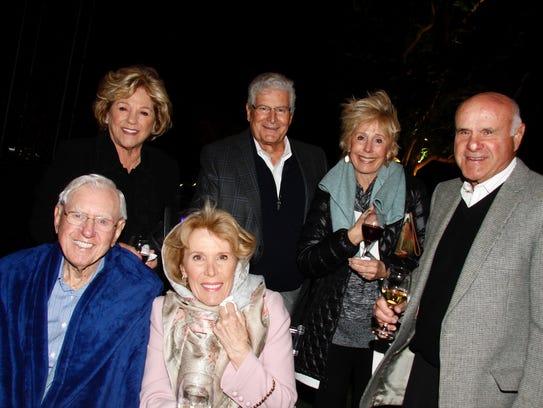 Standing (L) Marlene Chumo, John Curci, Susie and Ron