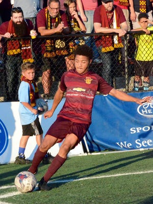 Detroit City FC forward Tyrone Mondi attempts a corner kick against AFC Ann Arbor in the National Premier Soccer League Midwest regional championship Saturday, July 29, 2017 at Keyworth Stadium in Hamtramck.