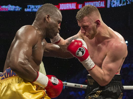 Adonis Stevenson, left, and Andrzej Fonfara battle during their first fight in 2014. Stevenson won by unanimous decision despite being knocked down. The rematch is Saturday.