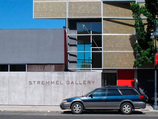 In this May 22, 2017, a parked car sits in front of the Stremmel Gallery, south of downtown Reno. The head of fine art galleries in New Mexico and New York City has filed a defamation suit against one of the world's largest Western American art auctions and the Reno gallery accusing them of falsely claiming a $1 million painting he sold is a fake. Gerald P. Peters is seeking unspecified damages from Peter Stremmel Galleries, the Coeur D'Alene Art Auction of Nevada and an organizer of the auction.