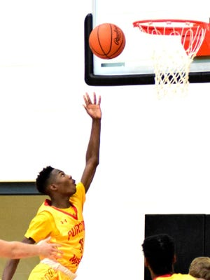 Purcell Marian's Payton Smith lays in two of his 13 points.