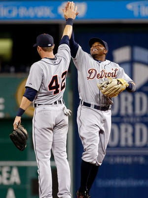 Detroit Tigers' Rajai Davis, right, celebrates as he leaves the field after the Tigers closed out a 1-0 win over the Pittsburgh Pirates in a baseball game in Pittsburgh on Wednesday, April 15, 2015.