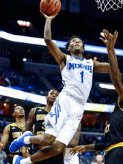 Memphis guard Jamal Johnson drives for a layup against the Northern Kentucky defense during first half action at the FedExForum in Memphis Tenn., Saturday, November 25, 2017.