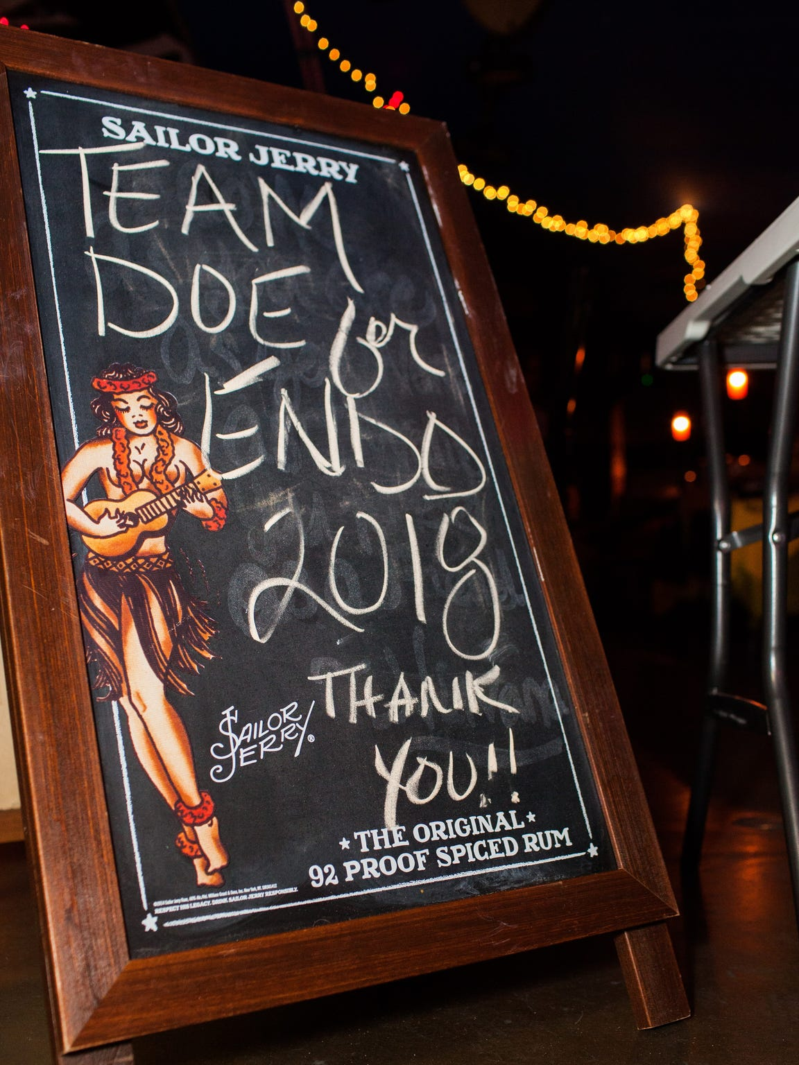 Party-goers are greeted by the Team Doe for Endo sign at the entrance of The Warehouse Bar on Saturday, Feb. 10.