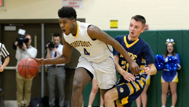 Irondequoit's Gerald Drumgoole, left, dribbles by Wayne's Tom Bolt during the Class A regional qualifier played at Rush-Henrietta High School on Wednesday, March. 7, 2018.