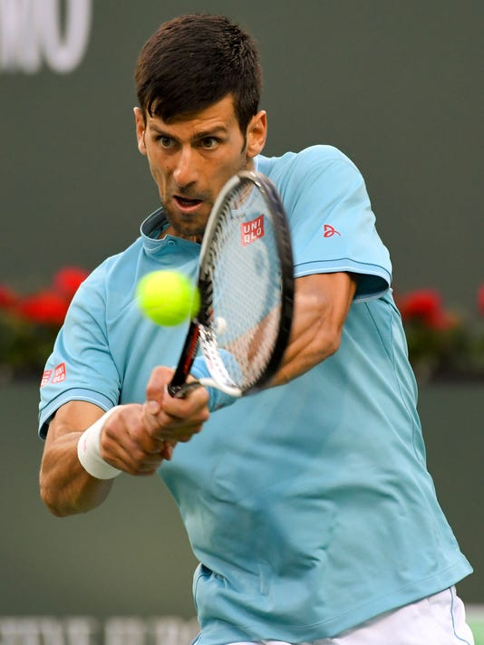 Novak Djokovic, of Serbia, hits to Kyle Edmund, of Britain, at the BNP Paribas Open tennis tournament, Sunday, March 12, 2017, in Indian Wells, Calif. (AP Photo/Mark J. Terrill)