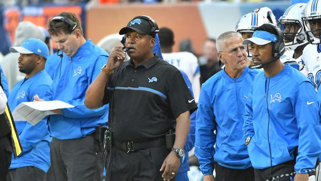 Lions head coach Jim Caldwell and members of the coaching staff on the sidelines in the second half of the 17-14 loss to the Chicago Bears.