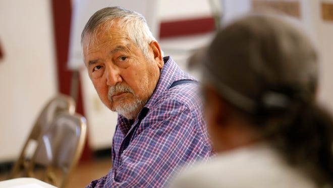 Gilbert Harrison Sr., San Juan River Farm Board president and farm board member for the Gadii'ahi-Tokoi Chapter, talks with Joe Ben Jr., a Shiprock Chapter House Farm Board member Tuesday during a meeting between tribal and federal official at the Gadii'ahi-Tokoi Chapter house.
