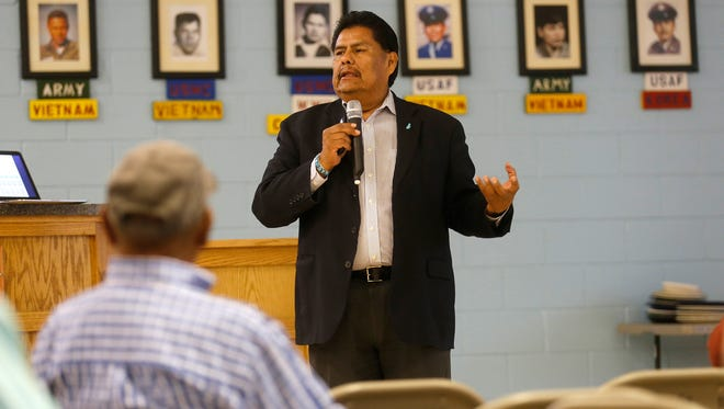 Mike Halona, chairman for Title 26 Task Force, talks to community members about a proposal to consolidate the Navajo Nation's chapter government structure during a meeting Wednesday at the Shiprock Chapter House.