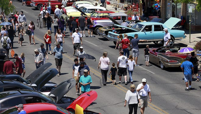 Car enthusiasts take in the Rod Run on July 16, 2016, on Main Street in Farmington. The event returns to downtown on Saturday.