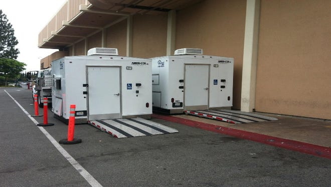 Downtwon Oxnard will get two temporary bathrooms that could look like the two pictured.