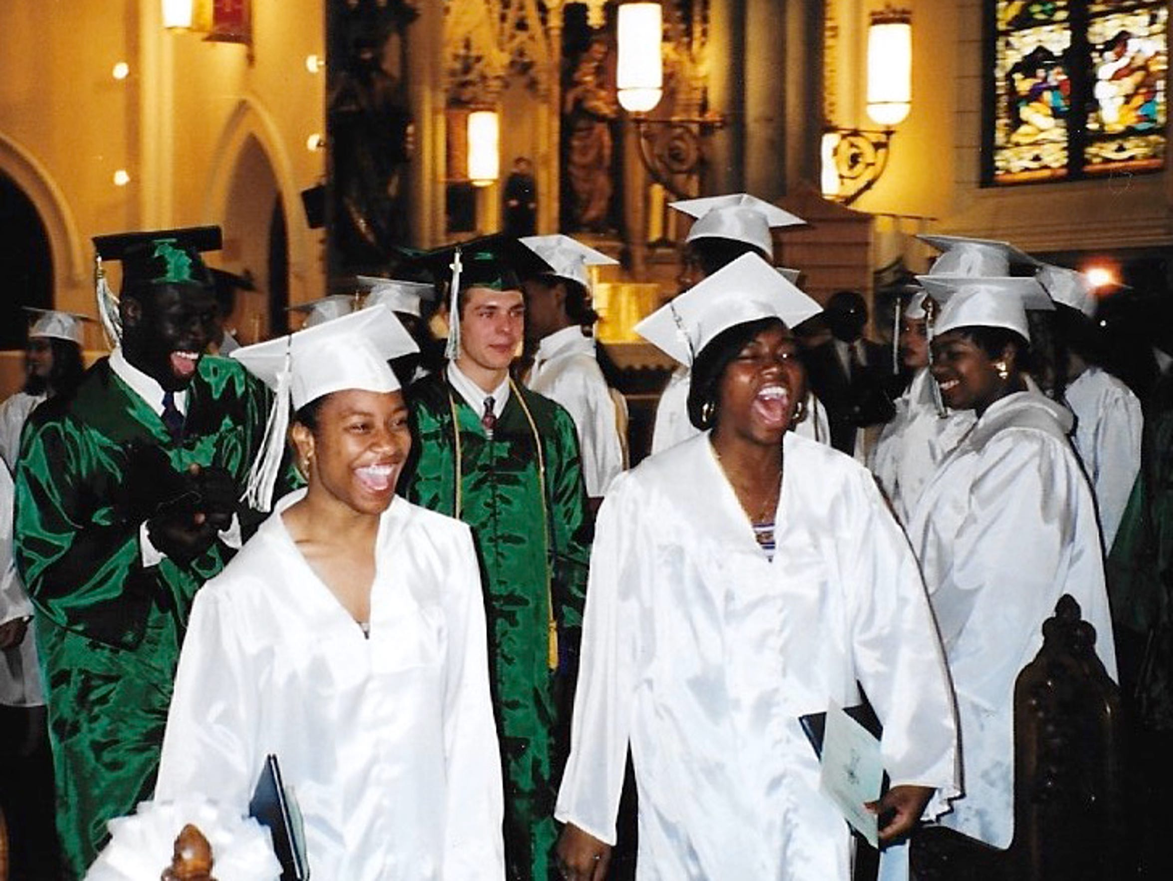 Corey Campbell, center, during his high school graduation