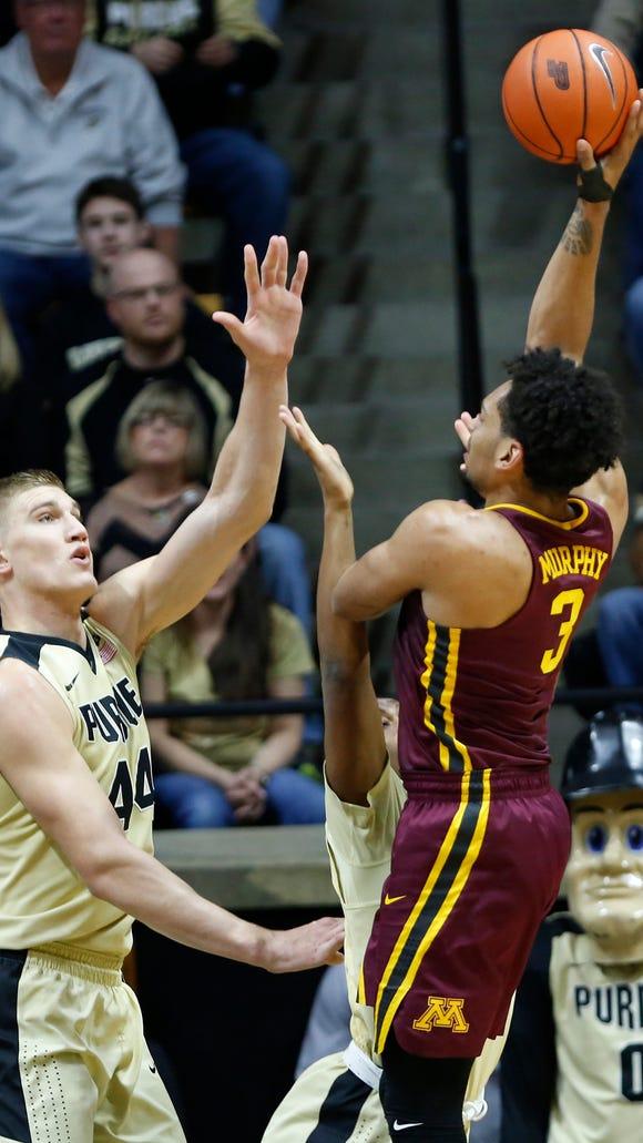 Minnesota's Jordan Murphy with a shot over Isaac Haas