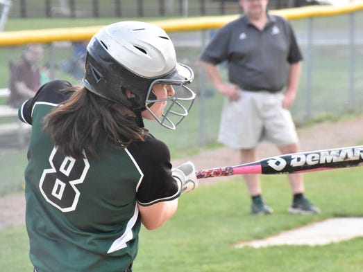 James Buchanan's Carly Caron swings at a pitch during