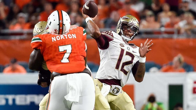 Florida State quarterback Deondre Francois throws a pass during the first half against Miami Hurricanes at Hard Rock Stadium Saturday. The Seminoles have won seven in a row against Miami.