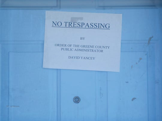 """A """"No Trespassing"""" sign is posted on the front door"""