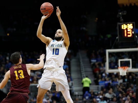 Nevada forward Caleb Martin shoots a 3-point shot against Loyola Chicago in a Sweet 16 game.