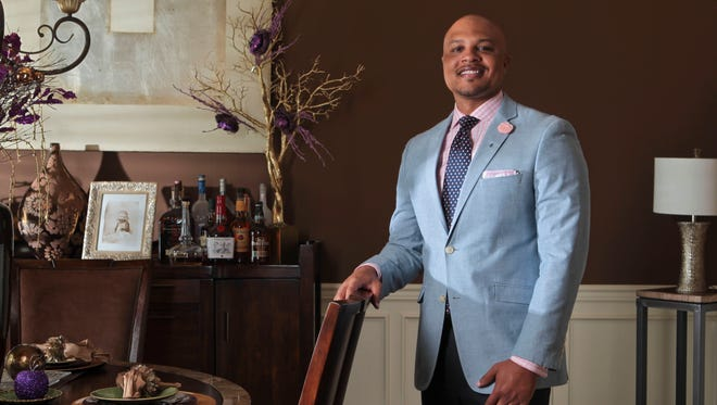 Gathan Borden is Director of Brand Marketing & Advertising at Louisville Convention & Visitors Bureau. He's also a dapper dresser who picked out the chocolate-colored paint for the dining room in the home he shares with his wife and two young children. May 28, 2014