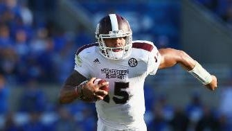 Mississippi State quarterback Dak Prescott's odds to win the Heisman dropped without playing a game this year.