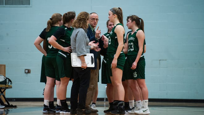 St. Johnsbury head coach Jack Driscoll talks to the team during a time out in the girls basketball game between the St. Johnsbury Hilltoppers and the Essex Hornets at Essex High School on Monday night February 12, 2018 in Essex. (BRIAN JENKINS/for the FREE PRESS)