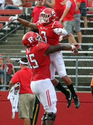Rutgers Scarlet Knights new head football coach Chris Ash coaches his first home game at High Point Solutions Stadium in Piscataway against the Bisons of Howard University on Saturday September 10, 2016.Rutgers # 3 (right) Jawuan Harris celebrates is 2nd half touchdown with team mate # 65 (left) Tariq Cole.
