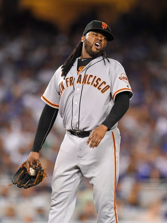 San Francisco Giants starting pitcher Johnny Cueto winces after injuring himself during the sixth inning of a baseball game against the Los Angeles Dodgers, Tuesday, Sept. 20, 2016, in Los Angeles. Cueto was taken out of the game soon after. (AP Photo/Mark J. Terrill)