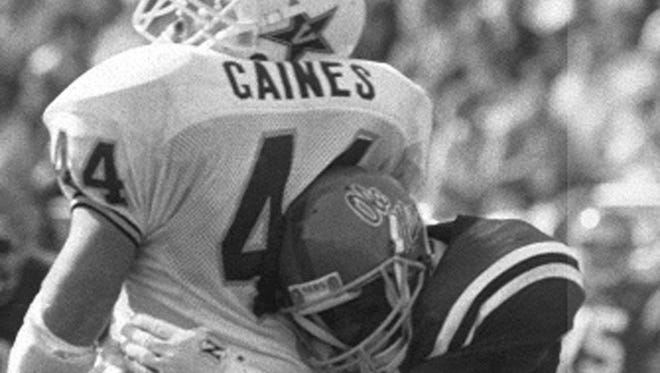 """Mississippi defensive back Roy Lee """"Chucky"""" Mullins hits Vanderbilt tight end Brad Gaines during their game Oct. 28, 1989 in Oxford, Miss. The hit not only paralyzed Mullins, it later took his life."""