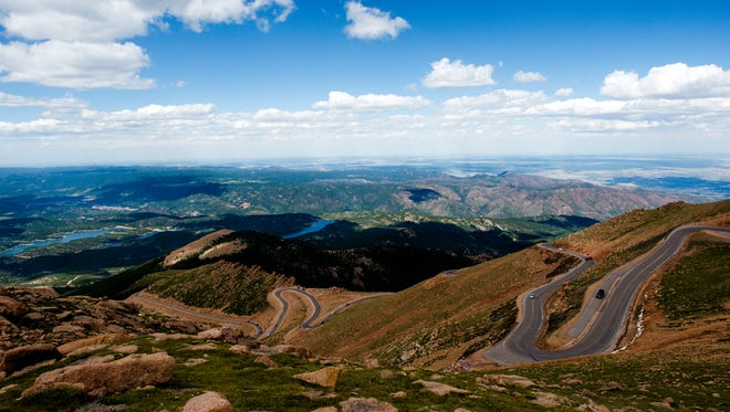 Visitors explore the sites near Pikes Peak Highway to the top of the mountain Tuesday, Aug. 4, 2015, near Colorado Springs, CO.