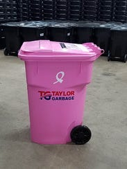 Taylor Garbage placed pink garbage cans throughout