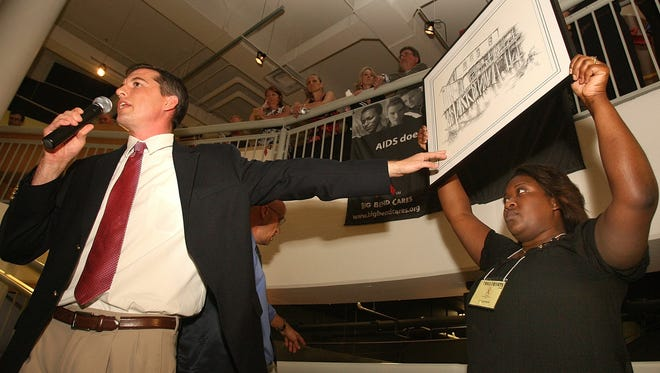 Auctioneer Malcolm Mason in a 2010 photo shouting bids on artwork during a live auction for Artopia.