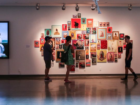 "Visitors check out  ""Pop Stars! Popular Culture and"