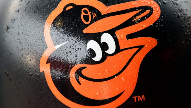 Rain drops stick to a Baltimore Orioles logo on a concourse trash can before a home opener baseball game against the Toronto Blue Jays, Friday, April 10, 2015, in Baltimore, as wet weather threatened the area. (AP Photo/Patrick Semansky)