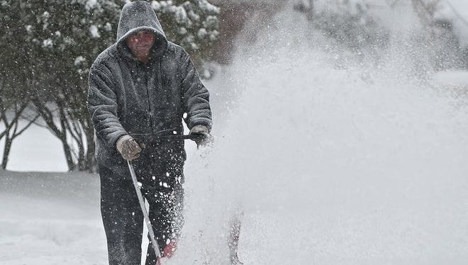John Long snowplows in Haddonfield in 2014.