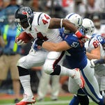 Colts linebacker Pat Angerer tries to stop Texan running back Ben Tate as he leaps through the line in the first half of the game at Reliant Stadium during the season opener against the Texans in Houston, Texas on Sunday, September 11, 2011. (Matt Detrich / The Star) <b>09/18/2011 - C01 - MAIN - 2ND - THE INDIANAPOLIS STAR</b><br />Colts linebacker Pat Angerer (51) tries to stop Texans running back Ben Tate as he leaps through the line in the first half last Sunday. The Colts defense allowed 259 yards and 34 points  in the first half last week, and 125 yards and no points  after halftime.