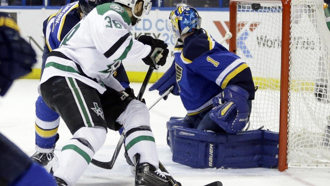 Dallas Stars' Vernon Fiddler, left, scores past St. Louis Blues goalie Brian Elliott during the first period of Game 6 of the NHL hockey Stanley Cup Western Conference semifinals, Monday in St. Louis.