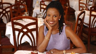 Barbara Smith shows off dishes at her Washington restaurant, B. Smith's, in 2002.
