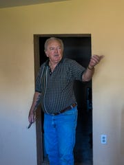 Steve Sussex stands in the doorway to his grandmother's