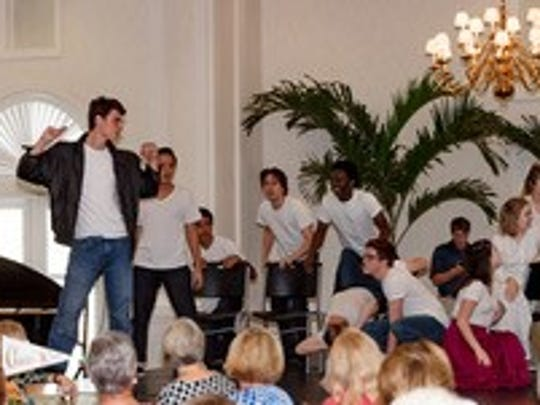 """Visual and performing arts students from Indian River Charter High Schoolperform a scene from """"Grease"""" at Impact 100's anniversary luncheon on Nov. 8. Michael Naffziger, the IRCHS theaterdirector, credited an Impact grant for providing the theaterwith necessary equipment."""