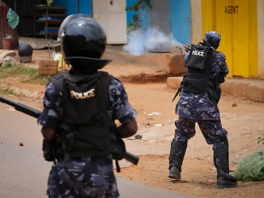 Riot police officers fire rubber bullets as they disperse