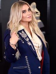 Kesha arrives at the 60th annual Grammy Awards at Madison