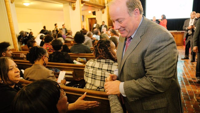 Detroit Mayor Mike Duggan greets people before a community town hall meeting to discuss city services and Detroit Mayor's plan to lower the cost of auto insurance at Historic Little Rock Baptist Church in Detroit on Wednesday, April 29, 2015.