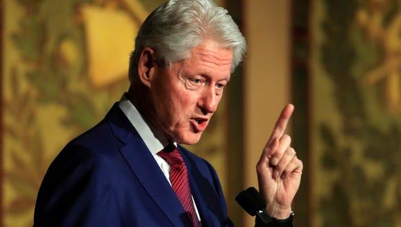 Former president Bill Clinton speaks during a symposium