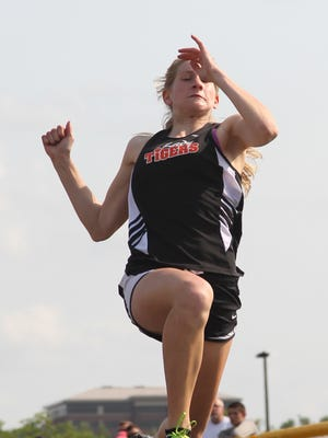Martha Kupfer flies through the air on her first jump in the long jump finals Wednesday at the WIAA Division 1 regional track meet at Wausau West.