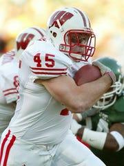 Wisconsin's Matt Bernstein rushes for a second-quarter