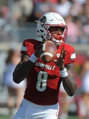 Louisville's Lamar Jackson (8) looks for an open receiver against Boston College on Saturday at Papa John's Cardinal Stadium. Oct. 14, 2017