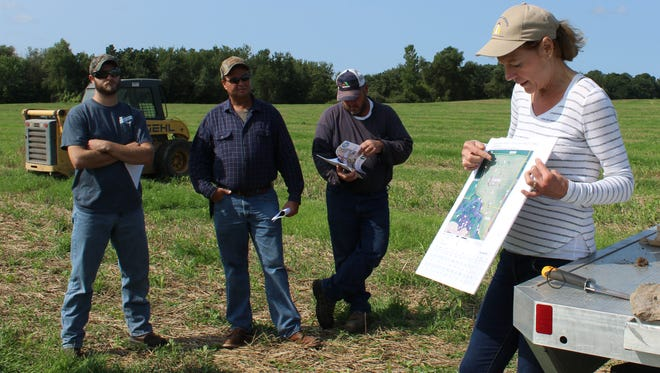 Becky Wagner uses a map to illustrate different soil needs on the Hiemstra farmily farm during  the Summer Field Day at the Brandon area farm on Aug. 24.