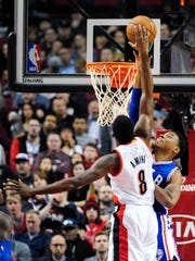Portland Trail Blazers forward Al-Farouq Aminu (8) is fouled by Philadelphia 76ers forward Richaun Holmes as he goes up to dunk during the first quarter of an NBA basketball game in Portland, Ore., Saturday, March 26, 2016. (AP Photo/Steve Dykes)
