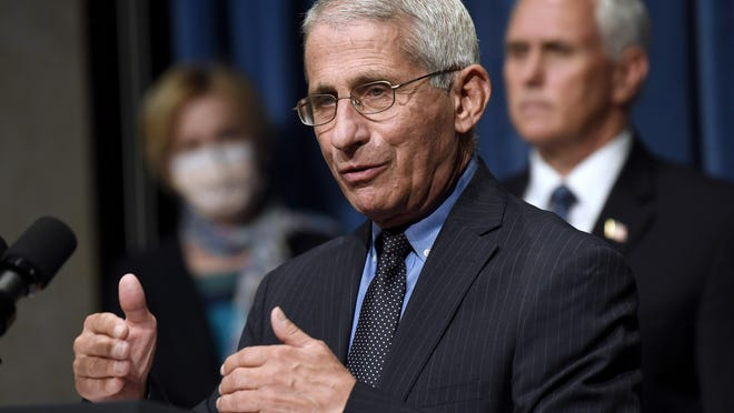 Dr. Anthony Fauci, director of the National Institute of Allergy and Infectious Diseases, speaks as Vice President Mike Pence, right, and Dr. Deborah Birx, left, listen during a news conference with members of the Coronavirus Task Force in Washingtonlast month.