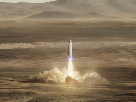 This artist's rendering made available by Elon Musk on Friday shows SpaceX's new mega-rocket design on Mars. With the 350-foot-tall spacecraft, Musk announced that his private space company aims to launch two cargo missions to the red planet in 2022.