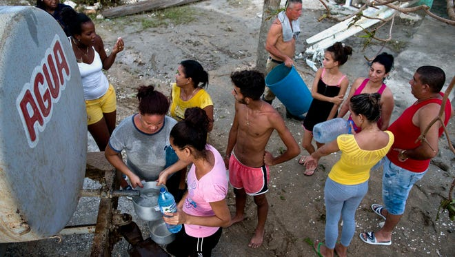 Locals affected by Hurricane Irma line up to collect drinking water in Isabela de Sagua, Cuba, on Sept. 11, 2017. The